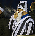 Bad Santa : An Ayr Utd Santa doesn't set a good example to the kids as he puffs away on a cigarette.