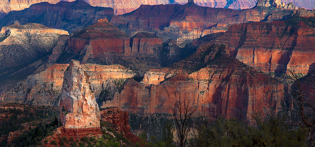 The setting sun spotlights Mount Hayden at Point Imperial at the North Rim of the Grand Canyon at Grand Canyon National Park, Arizona