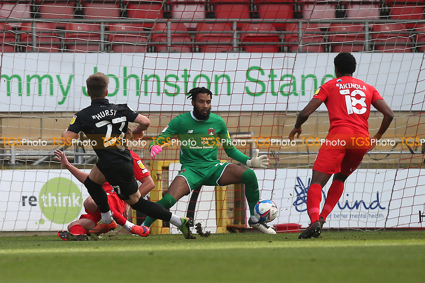 Lawrence Vigouroux of Leyton Orient denies Alex Hurst of Port Vale during Leyton Orient vs Port Vale, Sky Bet EFL League 2 Football at The Breyer Group Stadium on 20th February 2021