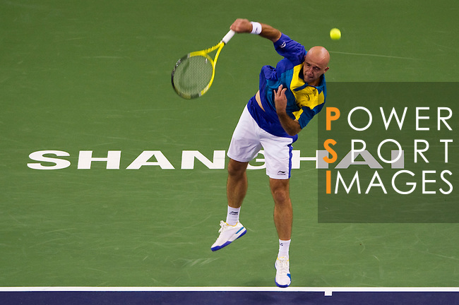 SHANGHAI, CHINA - OCTOBER 12:  Ivan Ljubicic of Croatia serves to Ze Zhang of China during day two of the 2010 Shanghai Rolex Masters at the Shanghai Qi Zhong Tennis Center on October 12, 2010 in Shanghai, China.  (Photo by Victor Fraile/The Power of Sport Images) *** Local Caption *** Ivan Ljubicic