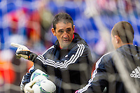New York Red Bulls goalkeeper coach Rafael Gonzalez talks with goalkeeper Luis Robles (31) prior to playing D. C. United. The New York Red Bulls and D. C. United played to a 0-0 tie during a Major League Soccer (MLS) match at Red Bull Arena in Harrison, NJ, on March 16, 2013.