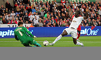 Pictured: Eder of Swansea (R) clashes with Scott Flinders of York City (R) before Nathan Dyer (not pictured) scores the opening goal Tuesday 25 August 2015<br /> Re: Capital One Cup, Round Two, Swansea City v York City at the Liberty Stadium, Swansea, UK.