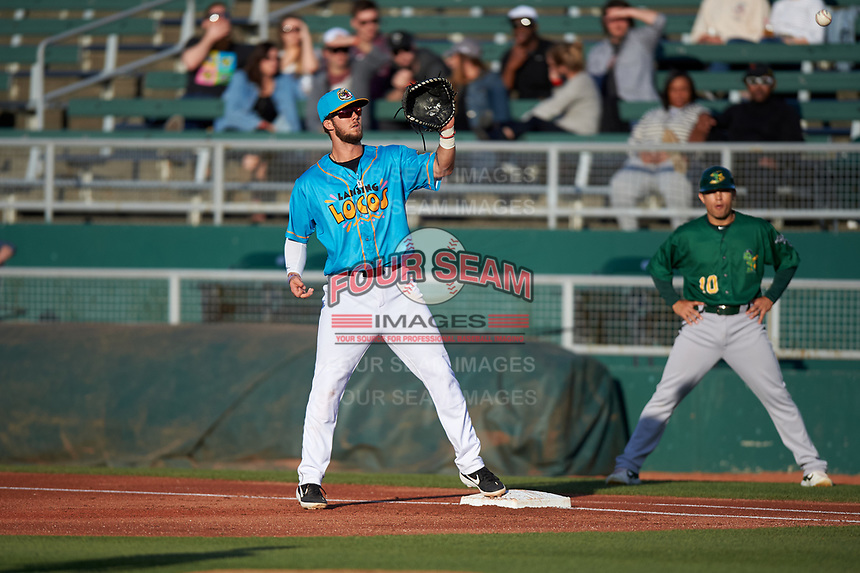 Lansing Lugnuts first baseman Jake Brodt (30) prepares to catch a ball during a Midwest League game against the Beloit Snappers at Cooley Law School Stadium on May 4, 2019 in Lansing, Michigan. The Lugnuts wore their Copa de la Diversión jerseys, becoming the Lansing Locos for the evening. Beloit defeated Lansing 2-1. (Zachary Lucy/Four Seam Images)