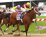 2011 05 20:R Holiday Mood with John Velazquez aborad wins the Miss Preakness Stakes, for 3 year olds fillies, at 6 furlongs, Pimlico Racetrack. Trainer Todd Pletcher. Owner E. Paul Robsham Stables
