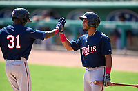 FCL Twins Emmanuel Rodriguez (4) high fives Alerick Soularie (31) after a home run during a game against the FCL Red Sox on August 7, 2021 at JetBlue Park at Fenway South in Fort Myers, Florida.  (Mike Janes/Four Seam Images)