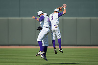 Winston-Salem Dash outfielders Jake Fincher (3), Aaron Schnurbusch (20), and Louis Silverio (15) celebrate their win over the Buies Creek Astros at BB&T Ballpark on April 16, 2017 in Winston-Salem, North Carolina.  The Dash defeated the Astros 6-2.  (Brian Westerholt/Four Seam Images)