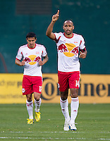 Thierry Henry (14) of New York Red Bulls salutes the crowd after scoring during the game at RFK Stadium in Washington, DC.  New York Red Bulls defeated D.C. United, 2-0.