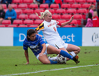Ashley Spivey (8) of Maryland is tackled by Mollie Pathman (24) of Duke at Ludwig Field on the campus of the University of Maryland in College Park, MD. DC. Duke defeated Maryland, 2-1.
