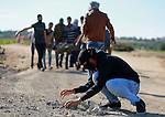 Palestinian protesters take part in clashes with Israeli troops near the border between Israel and central Gaza strip, October 30, 2015. Since the start of October, violence that has included stabbings as well as clashes between Palestinian protesters and Israeli security forces has killed at least 65 Palestinians and 10 Israelis. Photo by Yasser Qudih