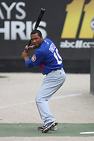 """Wilberto Ortiz #10 of the Chattanooga Lookouts """"standing in""""  the box while a pitcher warms up before a game against the Carolina Mudcats on May 22, 2011 at Five County Stadium in Zebulon, North Carolina. Photo by Robert Gurganus/Four Seam Images."""