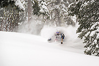 "Elyse Saugstad enjoying some ""Sierra Cement"" on a fine powder day on the west shore of Lake Tahoe."