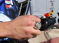 Feb. 17, 2013; Pomona, CA, USA; NHRA funny car driver Matt Hagan showing off his championship ring while signing autographs during the Winternationals at Auto Club Raceway at Pomona. Mandatory Credit: Mark J. Rebilas-