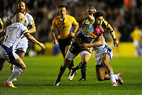 Ollie Lindsay-Hague of Harlequins is tackled by Jonathan Joseph of Bath Rugby