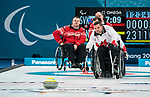 PyeongChang 14/3/2018 - Skip Mark Ideson sends a rock as Canada takes on Slovakia in wheelchair curling at the Gangneung Curling Centre during the 2018 Winter Paralympic Games in Pyeongchang, Korea. Photo: Dave Holland/Canadian Paralympic Committee