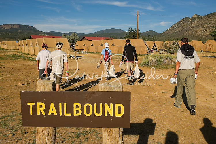 Photo story of Philmont Scout Ranch in Cimarron, New Mexico, taken during a Boy Scout Troop backpack trip in the summer of 2013. Photo is part of a comprehensive picture package which shows in-depth photography of a BSA Ventures crew on a trek. In this photo,  a BSA Venture makes their way back to their assigned base camp area with some of their issued equipment and food supplies at base camp at the Philmont Scout Ranch,  in Cimarron, New Mexico.<br /> <br /> Photo by travel photograph: PatrickschneiderPhoto.com
