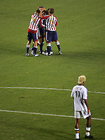 CD Chivas USA team celebrates their third goal of the game as LA Galaxy defender Abel Xavier (17) looks on. CD Chivas USA defeated the LA Galaxy in the Super Clasico 3-0 at the Home Depot Center in Carson, CA, Thursday, September 13, 2007.
