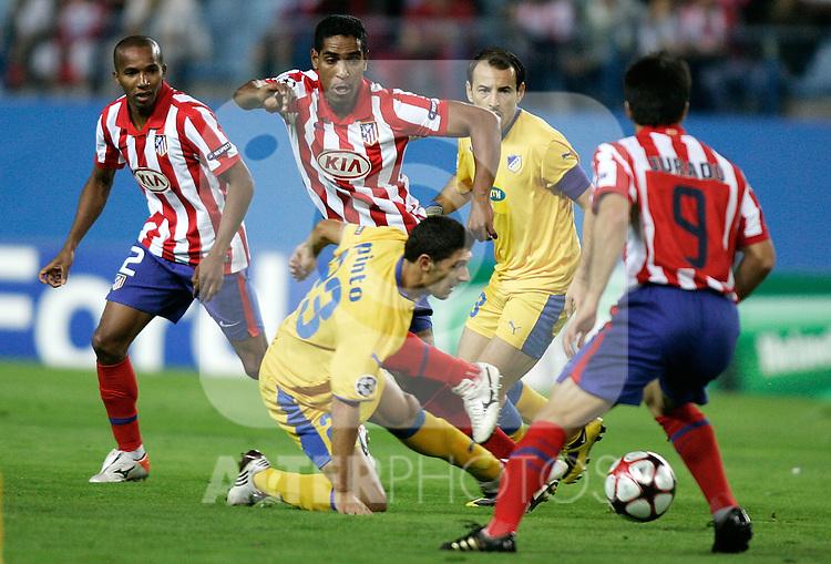 Atletico de Madrid's Cleber Santana against Apoel's Helio Pinto during UEFA Champions League match. September 15, 2009. (ALTERPHOTOS/Alvaro Hernandez).