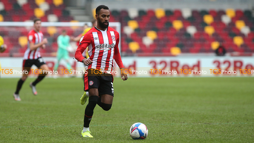 Rico Henry of Brentford in action during Brentford vs Barnsley, Sky Bet EFL Championship Football at the Brentford Community Stadium on 14th February 2021