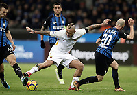 Calcio, Serie A: Inter - Roma, Milano, stadio Giuseppe Meazza (San Siro), 21 gennaio 2018.<br /> Roma's Radja Nainggolan (c) in action with Inter's Borja Valero (r) and Ivan Perisic (l) during the Italian Serie A football match between Inter Milan and AS Roma at Giuseppe Meazza (San Siro) stadium, January 21, 2018.<br /> UPDATE IMAGES PRESS/Isabella Bonotto