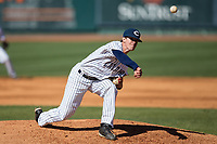 Catawba Indians relief pitcher Clay Young (31) delivers a pitch to the plate against the Wingate Bulldogs at Newman Park on March 19, 2017 in Salisbury, North Carolina. The Indians defeated the Bulldogs 12-6. (Brian Westerholt/Four Seam Images)