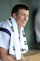 Starting pitcher Daniel Gossett (23) of the Clemson Tigers relaxes in the dugout after pitching 7 innings against the Elon College Phoenix on March 21, 2012, at Fluor Field at the West End in Greenville, South Carolina. Clemson's 4-2 win was Gossett's first college win and head coach Jack Leggett's 1,200th career win. (Tom Priddy/Four Seam Images)