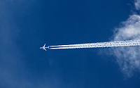 A jet travels through the blue skies of Southern Utah