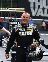 Jun 21, 2015; Bristol, TN, USA; NHRA top fuel driver Tony Schumacher during the Thunder Valley Nationals at Bristol Dragway. Mandatory Credit: Mark J. Rebilas-