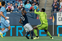 FOXBOROUGH, MA - SEPTEMBER 29: Cristian Penilla #70 of New England Revolution takes a shot and Sean Johnson #1 of New York City FC makes a save during a game between New York City FC and New England Revolution at Gillette Stadium on September 29, 2019 in Foxborough, Massachusetts.