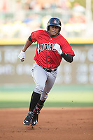 Willy Garcia (18) of the Indianapolis Indians hustles towards third base against the Charlotte Knights at BB&T BallPark on June 20, 2015 in Charlotte, North Carolina.  The Knights defeated the Indians 6-5 in 12 innings.  (Brian Westerholt/Four Seam Images)