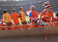 A Netherlands fans jumps over the wall after the FIFA World Cup first round match between Holland and Denmark at Soccer City in Johannesburg, South Africa on Monday, June 14, 2010.