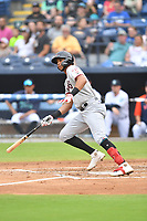 Hickory Crawdads Pedro Gonzalez (4) swings at a pitch during a game against the Asheville Tourists on July 20, 2021 at McCormick Field in Asheville, NC. (Tony Farlow/Four Seam Images)