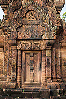 """Cambodia, Banteay Srei, Tenth Century A.D.  Indra, God of the Sky, on his Three-headed Elephant Airavata, creating rain to put out a fire in the Khandava Forest.  Northern """"library"""", east-facing pediment."""