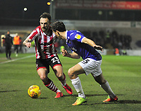 Lincoln City's Neal Eardley vies for possession with  Exeter City's Craig Woodman<br /> <br /> Photographer Andrew Vaughan/CameraSport<br /> <br /> The EFL Sky Bet League Two - Lincoln City v Exeter City - Tuesday 26th February 2019 - Sincil Bank - Lincoln<br /> <br /> World Copyright © 2019 CameraSport. All rights reserved. 43 Linden Ave. Countesthorpe. Leicester. England. LE8 5PG - Tel: +44 (0) 116 277 4147 - admin@camerasport.com - www.camerasport.com