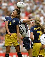 Jane Toernqvist, left, Abby Wambach, right, 2003 WWC USA Sweden.