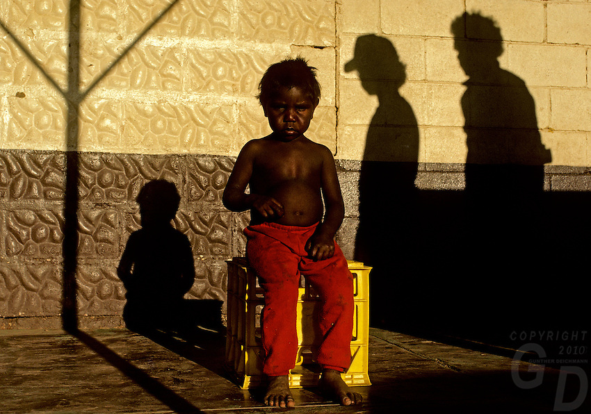 Images from the Book Journey Through Colour and Time, Outback of Australia, Aboriginal Boy and Shadows out side a pub, Northern Territory.