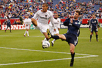 TheMetroStars' Craig Ziadie goes for the ball against the New England Revolution's Pat Noonan. Noonan scored the Revolution's only goal. The New England Revolution tied the NY/NJ MetroStars one all at Gillette Stadium, Foxborough, MA, on May 22, 2004.