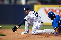 New York Yankees second baseman Gleyber Torres (25) waits to receive a throw as Teoscar Hernandez (37) slides into second base during a Grapefruit League Spring Training game against the Toronto Blue Jays on February 25, 2019 at George M. Steinbrenner Field in Tampa, Florida.  Yankees defeated the Blue Jays 3-0.  (Mike Janes/Four Seam Images)