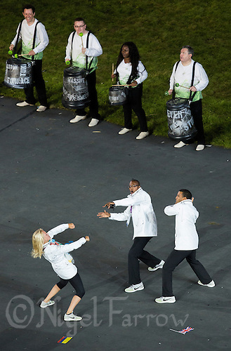 27 JUL 2012 - LONDON, GBR - Competitors celebrate arriving in the Olympic Stadium during the Opening Ceremony of the London 2012 Olympic Games in Stratford, London, Great Britain .(PHOTO (C) 2012 NIGEL FARROW)