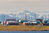Native inupiat village of kaktovik on Barter Island, Arctic coast of Alaska. Romanzof Mountains of the Brooks Range, anwr, in the distance.