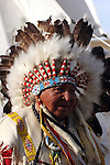 A Native American Indian Chief by a tipi