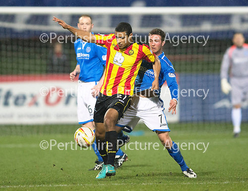 Partick Thistle v St Johnstone....21.01.14   SPFL<br /> Lyle Taylor and Chris Millar<br /> Picture by Graeme Hart.<br /> Copyright Perthshire Picture Agency<br /> Tel: 01738 623350  Mobile: 07990 594431