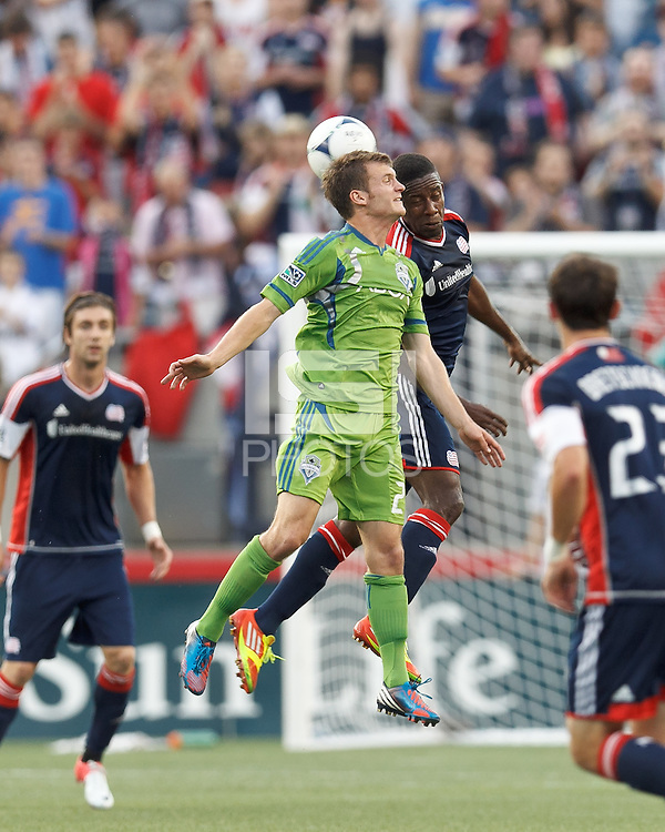 Seattle Sounders FC midfielder Alex Caskey (27) and New England Revolution midfielder Clyde Simms (19) battle for head ball. In a Major League Soccer (MLS) match, the New England Revolution tied the Seattle Sounders FC, 2-2, at Gillette Stadium on June 30, 2012.