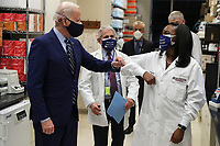 President Joe Biden greets Kizzmekia Corbett, an immunologist with the Vaccine Research Center at the National Institutes of Health during a visit at the Viral Pathogenesis Laboratory at the National Institutes of Health on Thursday, February 11, 2021 in Bethesda, Maryland. <br /> CAP/MPI/RS<br /> ©RS/MPI/Capital Pictures