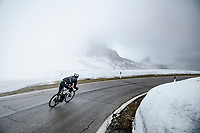Mauro Schmid (SUI/Qhubeka ASSOS) coming down the misty Passo Giau<br /> <br /> due to the bad weather conditions the stage was shortened (on the raceday) to 153km and the Passo Giau became this years Cima Coppi (highest point of the Giro).<br /> <br /> 104th Giro d'Italia 2021 (2.UWT)<br /> Stage 16 from Sacile to Cortina d'Ampezzo (shortened from 212km to 153km)<br /> <br /> ©kramon
