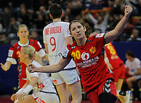 BELGRADE, SERBIA - DECEMBER 16: Milena Knezevic of Montenegro (C) celebrates the goal during the Women's European Handball Championship 2012 gold medal match between Norway and Montenegro at Arena Hall on December 16, 2012 in Belgrade, Serbia. (Photo by Srdjan Stevanovic/Getty Images)