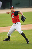 Starting pitcher Cameron Bayne #10 of the Kannapolis Intimidators makes a throw to first base after fielding a bunt against the Delmarva Shorebirds at Fieldcrest Cannon Stadium May 14, 2010, in Kannapolis, North Carolina.  Photo by Brian Westerholt / Four Seam Images