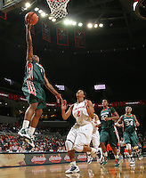 Jan. 6, 2011; Charlottesville, VA, USA; Miami Hurricanes guard Riquna Williams (1) shoots the ball in front of Virginia Cavaliers guard Whitny Edwards (2) during the game at the John Paul Jones Arena. Miami won 82-73. Mandatory Credit: Andrew Shurtleff-