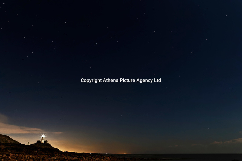 WEATHER PICTURE<br /> Pictured: Stars are visible during a clear night over Mumbles Lighthouse in Bracelet Bay, south Wales, UK. Wednesday 28 February 2018<br /> Re: Strong cold winds from the east have been affecting most parts of the UK with temperatures in some parts below zero.