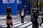 A person dressed in a Trump costume pretends to direct traffic on 5th Avenue as people gather in the streets in celebration after former Vice President Joe Biden was declared the winner of the 2020 presidential election between U.S. President Donald Trump and Biden on November 7, 2020 in New York City.  Photograph by Michael Nagle