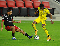 WASHINGTON, DC - OCTOBER 28: Luis Diaz #12 of Columbus Crew SC battles for the ball with Edison Flores #10 of D.C. United during a game between Columbus Crew and D.C. United at Audi Field on October 28, 2020 in Washington, DC.